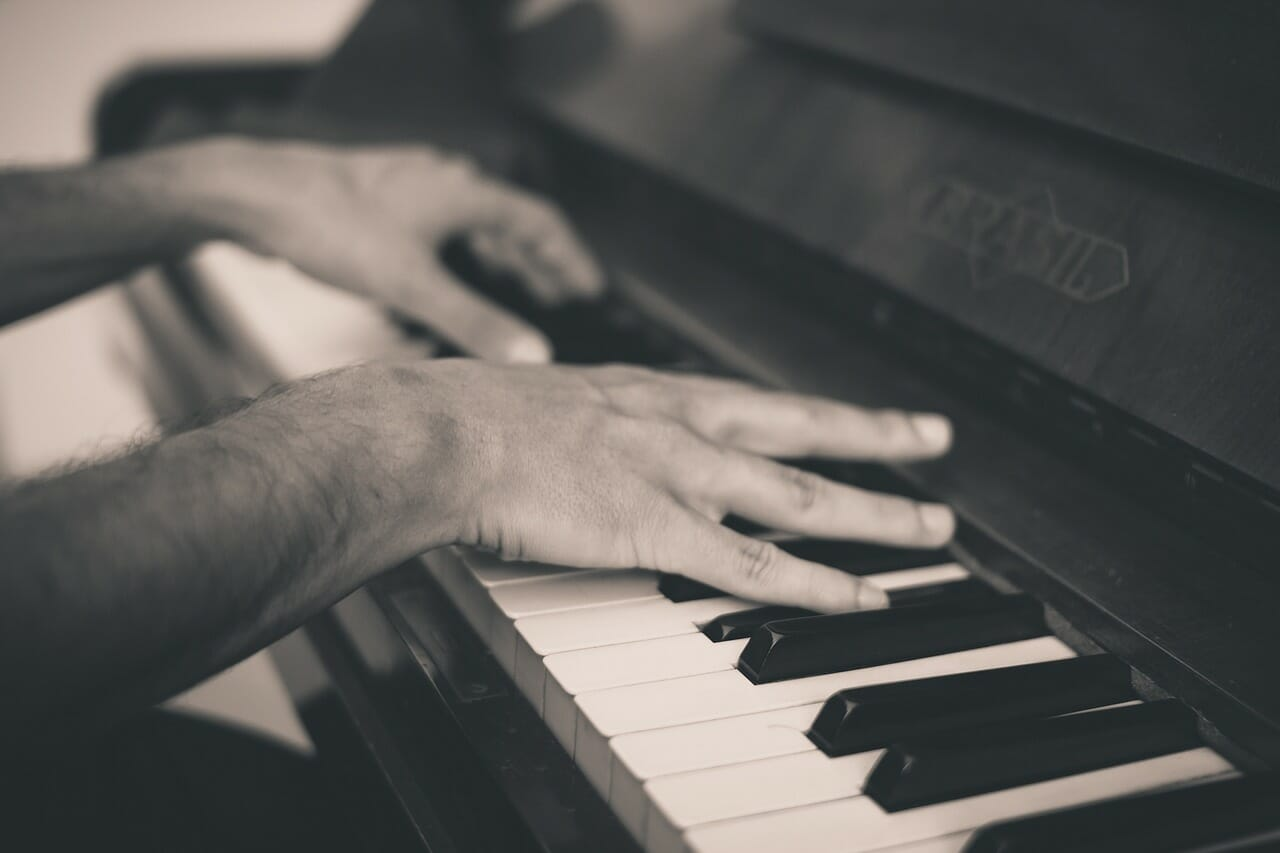 closeup of a man playing the piano